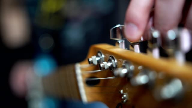 tuning guitar - guitar stock videos & royalty-free footage