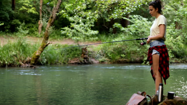 tuning out when fishing - packed lunch stock videos & royalty-free footage