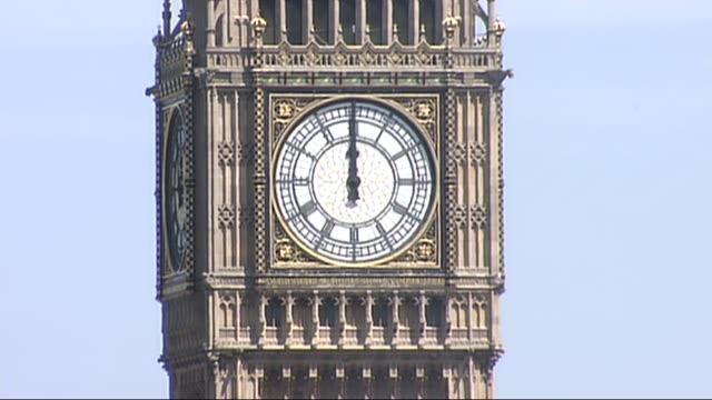 big ben strikes noon to begin minute's silence england london ext close shot of big ben clock tower at noon bell tolls sot - mittag stock-videos und b-roll-filmmaterial
