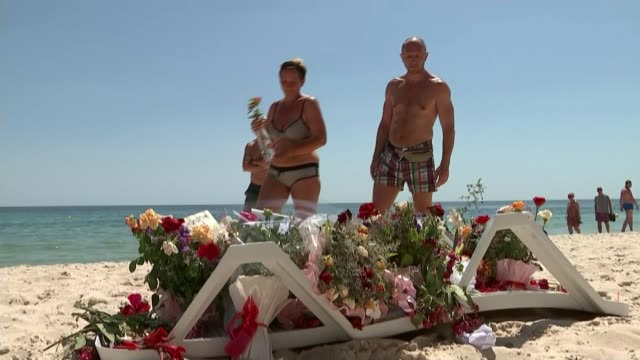 tunisia beach attack inquest hears local security teams had deliberately slowed down on way to scene t28061503 / 2862015 ext people placing flowers... - makeshift stock videos and b-roll footage