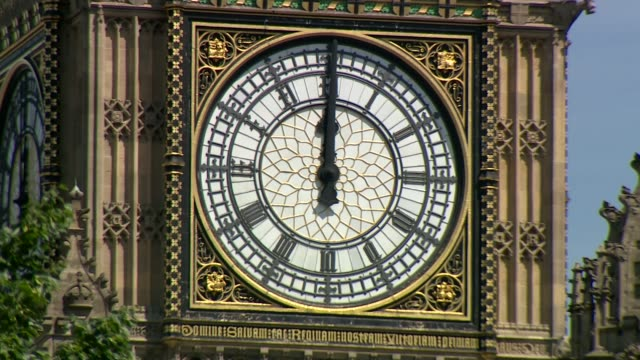 uk observes minute's silence in memory of victims england london ext clock face of big ben showing midday / 12 noon big ben chimes heard/ tourists... - midday stock videos and b-roll footage
