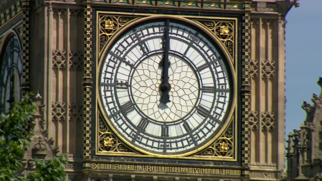 uk observes minute's silence in memory of victims england london westminster ext big ben clock face striking at 12 o clock noon sot - mittag stock-videos und b-roll-filmmaterial