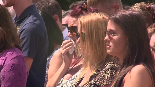 uk observes minute's silence in memory of victims joanne willetts stands with tow other women during minute's silence/ joanne willetts interview sot - godmother stock videos & royalty-free footage