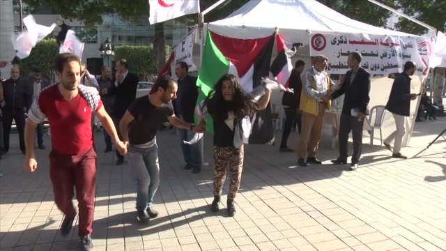 tunisian cities on saturday demonstrated in solidarity with palestine as part of that country's land day commemorations protests were held in... - palestinian flag stock videos & royalty-free footage