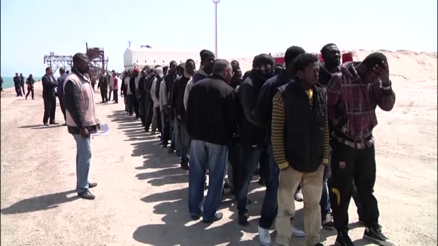 tunisian coast guard command rescue 2 boats carrying 175 illegal immigrants as they proceed towards the lampedusa island from libya in zarzistunisia... - undocumented immigrant stock videos & royalty-free footage