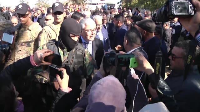 tunisian defense minister abdel karim al zubaidi attends a ceremony marking the third anniversary of jihadist attacks foiled by tunisian security... - jihad stock videos & royalty-free footage