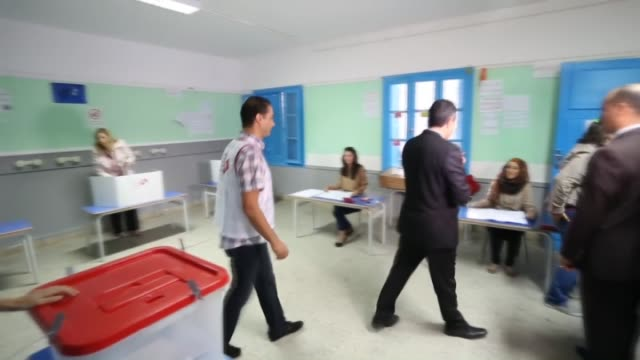 tunisian prime minister mehdi jomaa casts his ballot for parliamentary election at ibn khaldun polling station in carthage tunis on october 26 2014... - carthage tunisia stock videos & royalty-free footage