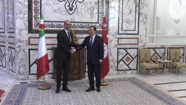 Tunisian Foreign Minister Humeys AlCihinavi meets with Italian Foreign Minister Angelino Alfano in Tunis Tunisia on January 16 2018 Tunisian Foreign...