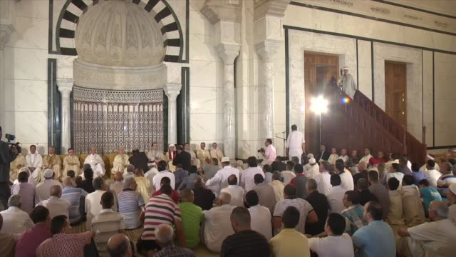 tunisian muslims perform eid alfitr prayer on the first day of threeday eid alfitr festival marking the end of the holy fasting month of ramadan at... - carthage tunisia stock videos & royalty-free footage