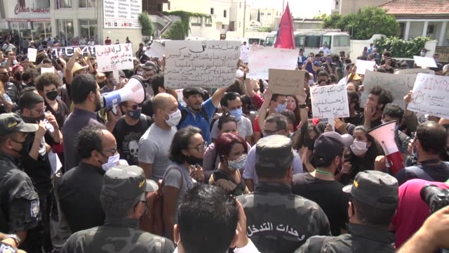 """tunisian ngos and activists gather in front of the tunisian parliament to protest against a controversial bill aimed at """"protecting"""" the security... - tunisia stock videos & royalty-free footage"""