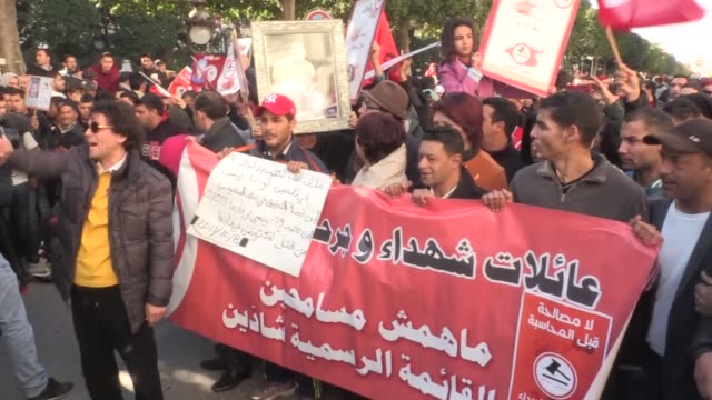 tunisian people wave flags during the celebration to mark the seventh anniversary of the jasmine revolution at the avenue habib bourguiba in tunis... - revolution stock videos & royalty-free footage
