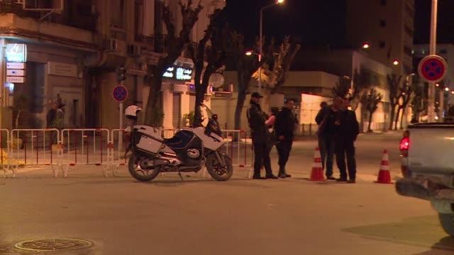 tunisian police cordon off the state radio broadcaster as a precaution after receiving terrorist threats according to their ceo abderrazak tabib - seilabsperrung stock-videos und b-roll-filmmaterial