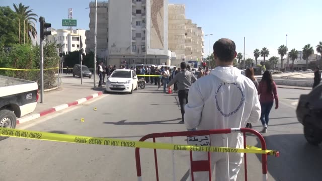vidéos et rushes de tunisian police inspect the scene of a knife attack on a traffic police patrol near the parliament building in tunis, tunisia on november 01, 2017. a... - bâtiment du parlement