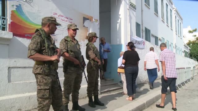 tunisian security forces stand outside polling stations to ensure a safe election process as some seven million voters head to the polls to choose... - tunis stock videos & royalty-free footage