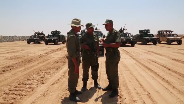 tunisian soldiers patrol as the entrenching works, planned along the border from ras ajder border gate to dehiba region, aimed at boosting security... - tunisia stock videos & royalty-free footage
