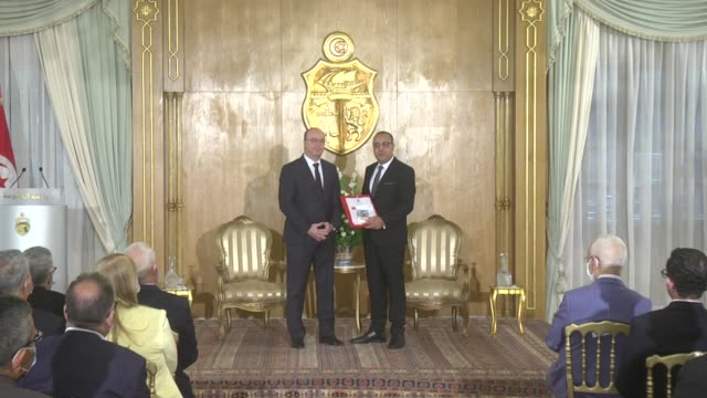 tunisia's new prime minister hichem mechichi gets documents from outgoing prime minister elyes fakhfakh during the handover ceremony at carthage... - carthage tunisia stock videos & royalty-free footage