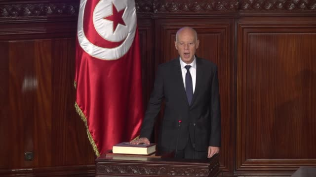 tunisia's president-elect kais saied took the oath of office on wednesday before the national assembly . the former law professor was elected... - oath stock videos & royalty-free footage