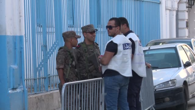 tunisia's security forces are in place in front of polling stations as the second round of the presidential election takes place - tunis stock videos & royalty-free footage