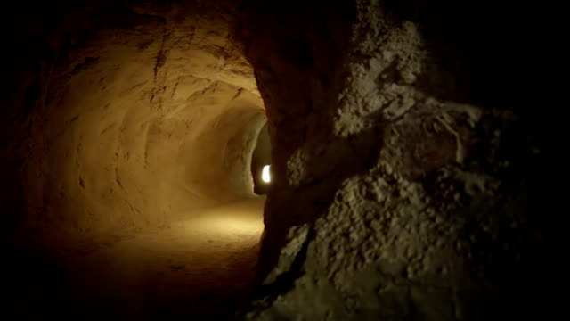 tunnel in the cave - digging stock videos and b-roll footage