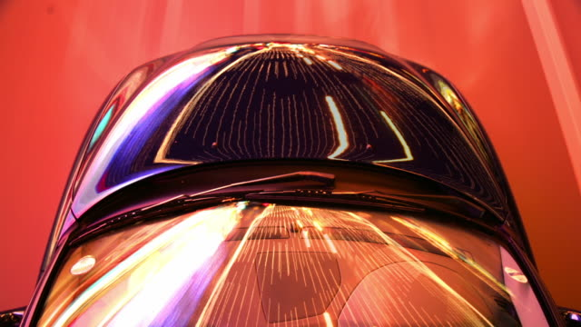 tunnel lights reflect on the hood and windshield of a driving car. - bonnet stock videos & royalty-free footage