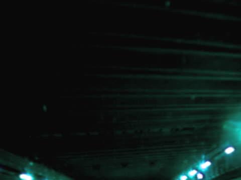 vídeos de stock, filmes e b-roll de tunnel lit up at night - tunnel