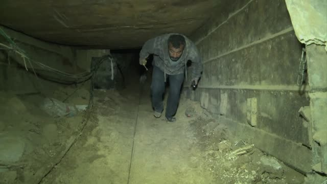 tunnel operators in rafah on the border between egypt and gaza say tunnels are being flooded by sewage water from the egyptian side weakening their... - smuggling stock videos and b-roll footage