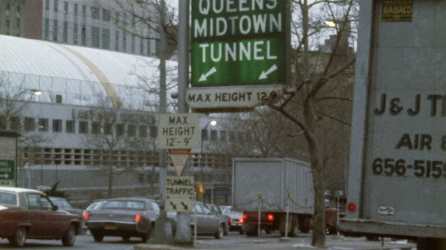 1978 montage ms td cu la tunnel sign and downtown traffic, new york city, new york state, usa - 1978 video stock e b–roll