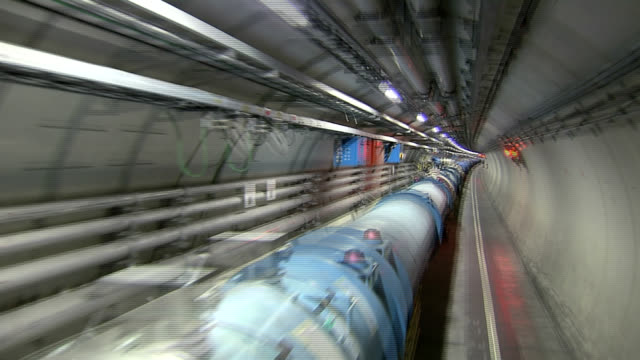 lhc tunnel. the lhc (large hadron collider) in its tunnel at cern (the european particle physics laboratory) near geneva, switzerland. - tunnel video stock e b–roll