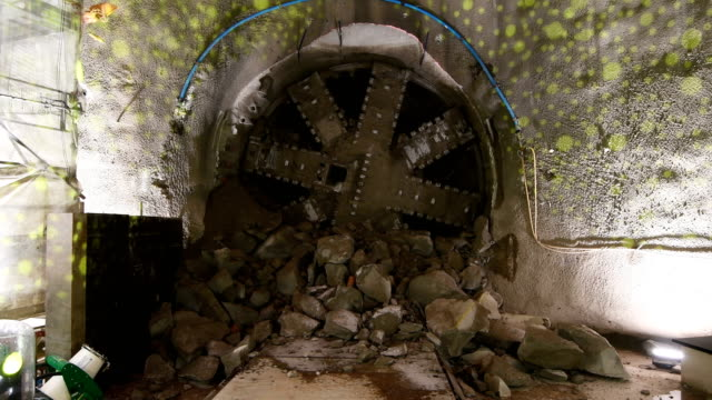 A tunnelling machine breaks through after completing the tunnelling for the Northern line extension from Kennington to Battersea Power Station on...