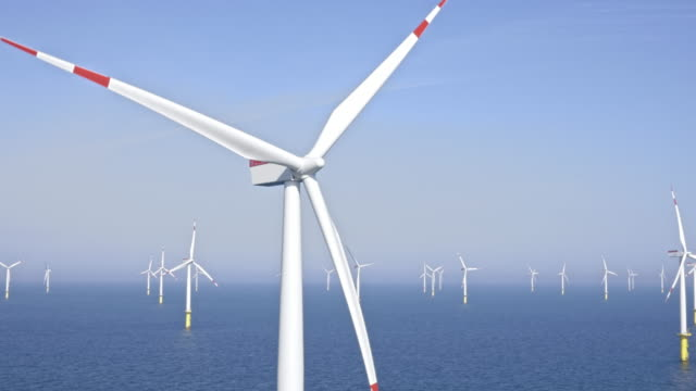 aerial turbine at offshore wind farm shining in the sun - propeller stock videos & royalty-free footage