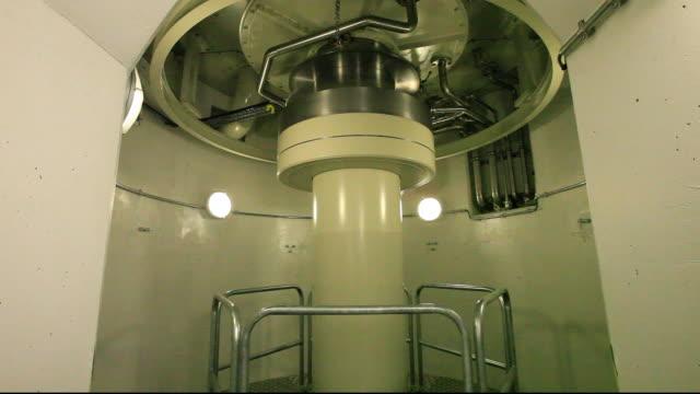 a turbine at the karahnjukar power station, a hydro plant that generates 40% of icelands electricity. - wasserkraft stock-videos und b-roll-filmmaterial
