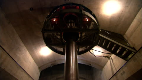 a turbine spins in the interior of the hoover dam. - turbine stock videos & royalty-free footage
