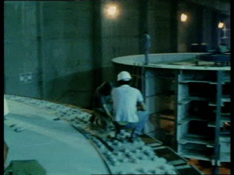 turbines being installed in itaipu dam brazil nov 82 - erezione video stock e b–roll