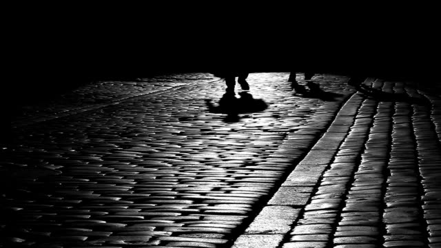 Turist in Cracov, shadows, black and white
