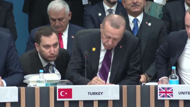 turkeish president recep tayyip erdogan attends the plenary session of the nato summit at the grove hotel in watford northeast of london on december... - horizontal stock videos & royalty-free footage