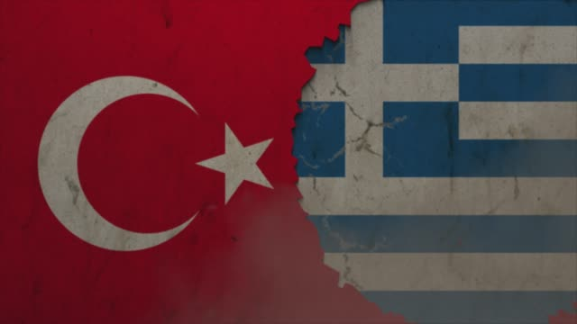turkey and greece flags on the stone wall stock video - greece stock videos & royalty-free footage