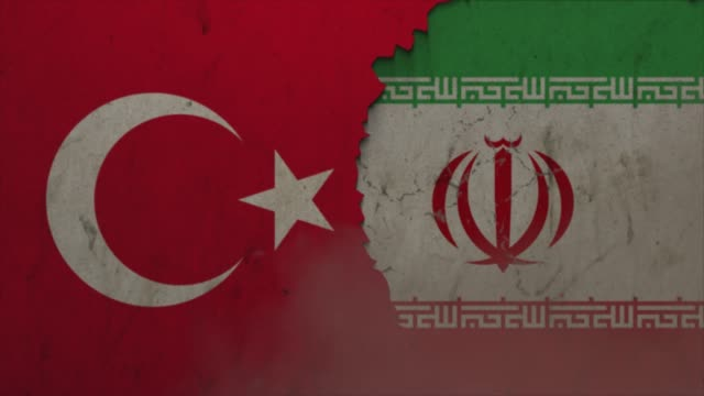 turkey and iran flags on the stone wall stock video - iran stock videos & royalty-free footage