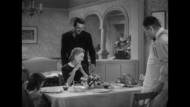 1941 A turkey is enjoyed by family (Irene Dunne and Cary Grant), their daughter, and friend (Edgar Buchanan)