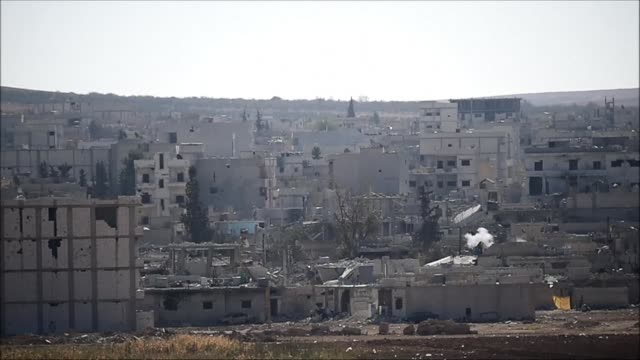 vídeos y material grabado en eventos de stock de turkey is pursuing a delicate but dangerous strategy after allowing peshmerga fighters to transit its soil to the besieged syrian town of kobane... - aprobado