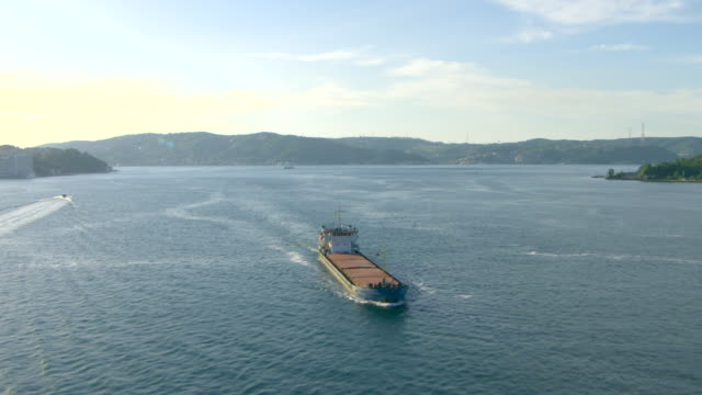 turkey, istanbul: bosphorus detroit and cargo boat - bosphorus stock videos & royalty-free footage
