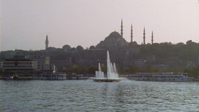 ws. pan, turkey, istanbul, cityscape with suleymaniye mosque, golden horn inlet in foreground - suleymaniye mosque stock videos and b-roll footage