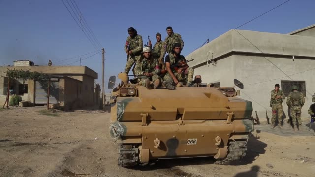 turkeybacked syrian national army are seen in syria's tal abyad district as operation peace spring continues on october 13 2019 the western part of... - southern european stock videos & royalty-free footage