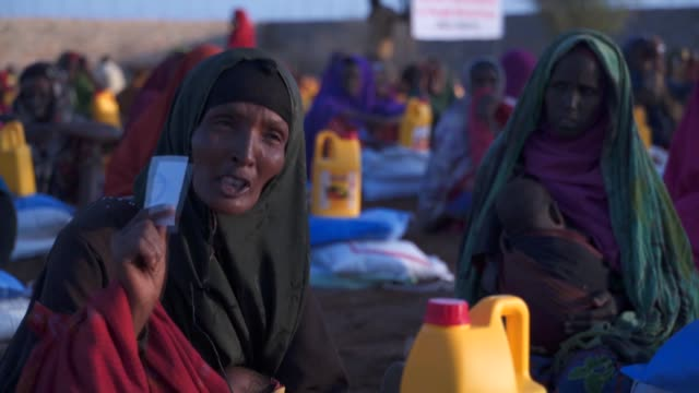 turkey's aid agency has distributed food to thousands of families facing dire hunger in the droughtstricken nation of somalia on march 27 2017... - horn of africa stock videos and b-roll footage
