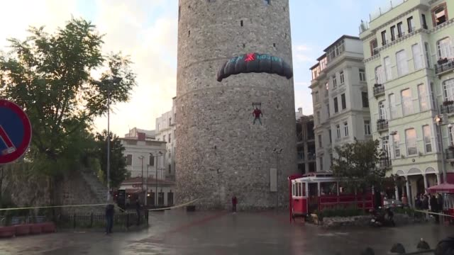 turkey's best known base jumper successfully leaps from the iconic galata tower in istanbul following in the footsteps of a legendary ottoman aviator... - ottoman stock videos and b-roll footage