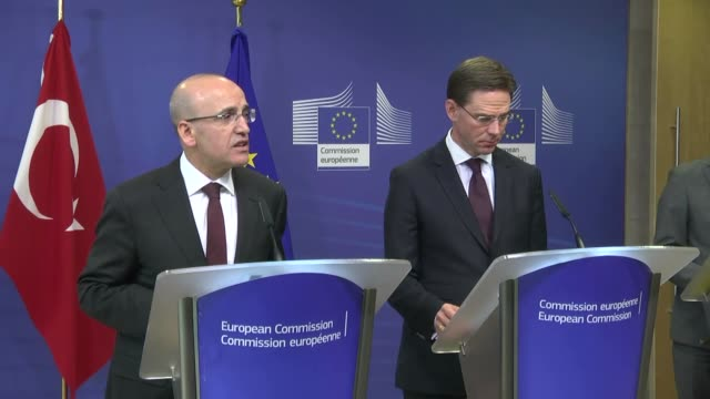 Turkey's Deputy Prime Minister Mehmet Simsek and Jyrki Katainen European Commission VicePresident for Jobs Growth Investment and Competitiveness hold...