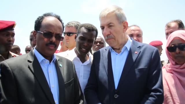 Turkey's Health Minister Ahmet Demircan is welcomed by Somali Deputy Prime Minister Mahdi Ahmed Guled Foreign Minister Yusuf Garaad Omar and Health...