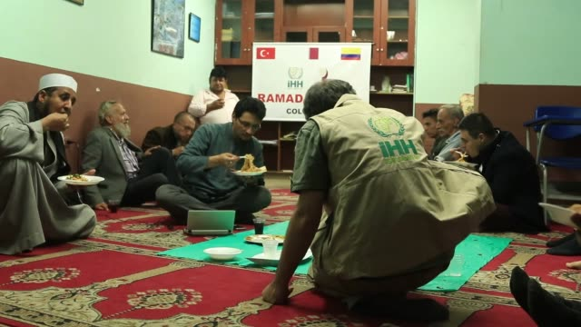 turkey's humanitarian relief foundation distribute food packages to needy families in bogota and medellin colombia during muslim holy month ramadan... - medellin colombia stock videos & royalty-free footage