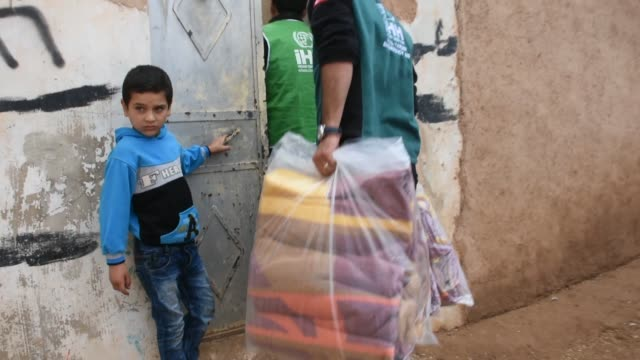 Turkey's Humanitarian Relief Foundation distributes food aid to struggling 3600 families at the city of AlBab and its towns in Aleppo province on...