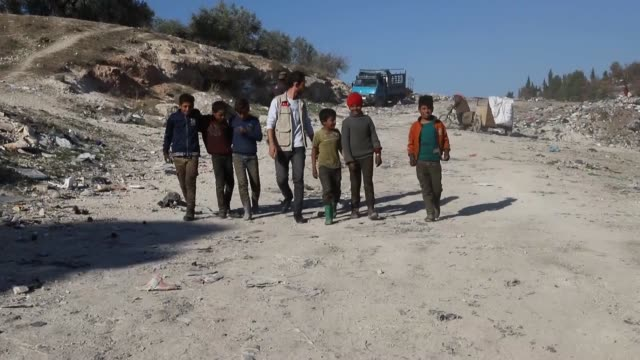 turkey's humanitarian relief foundation gives gifts to syrian children on the occasion of the world children's day in afrin, syria on november 20,... - war stock-videos und b-roll-filmmaterial