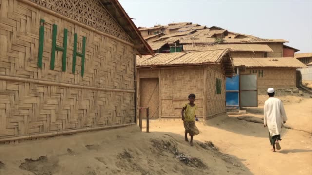stockvideo's en b-roll-footage met turkey's humanitarian relief foundation has installed solar energy panels on its 5,795 bamboo houses built for rohingya refugees in bangladesh.... - number 9